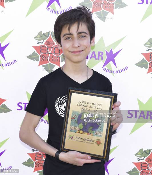 Actor Aidan Gallagher poses for portrait with award at 17th Annual Children's Earth Day Extravaganza at Star Eco Station on April 2 2017 in Culver...