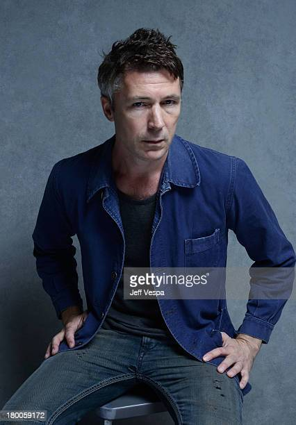 Actor Aidan Gillen of 'Beneath The Harvest Sky' poses at the Guess Portrait Studio during 2013 Toronto International Film Festival on September 8...