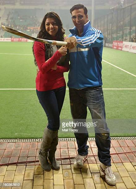 Actor Akshay Kumar and actress Kajal Aggarwal during the HIL match between Delhi Waveriders vs Punjab Warriors at MDC National stadium in New Delhi...