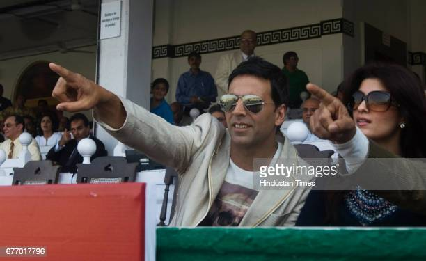 Actor Akshay Kumar and wife Twinkle Khanna watch the Sobo Central Indian 2000 Guineas derby at Mahalakshmi Racecourse on Sunday where they betted and...