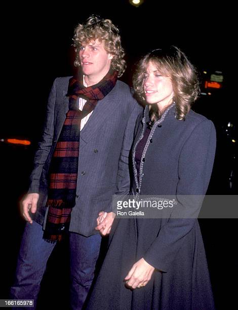 Actor Al Corley and Musician Carly Simon attend Marci Klein's Sweet Sixteen Birthday Party on October 22 1982 at Studio 54 in New York City New York