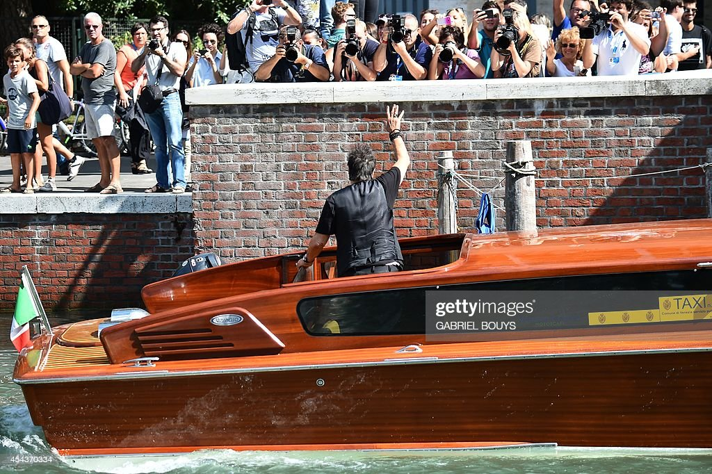 US actor Al Pacino waves to fans from a taxi boat during the 71st Venice Film Festival on August 30 2014 at Venice Lido AFP PHOTO / GABRIEL BOUYS
