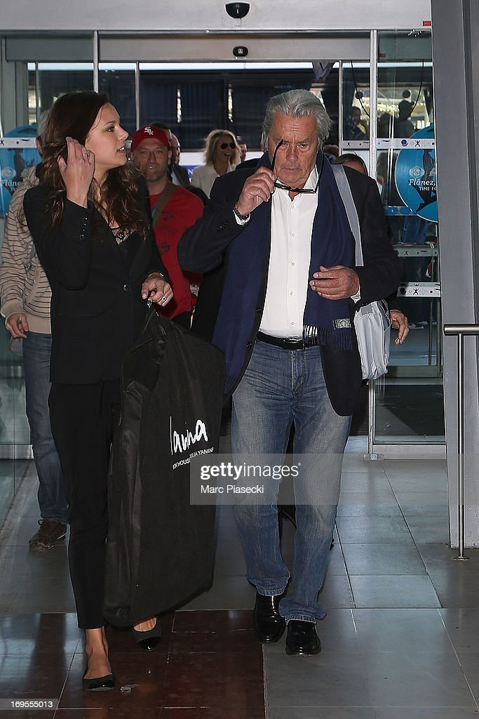Actor Alain Delon (R) and Marine Lorphelin (L) are sighted at Nice airport after the 66th Annual Cannes Film Festival on May 27, 2013 in Nice, France.