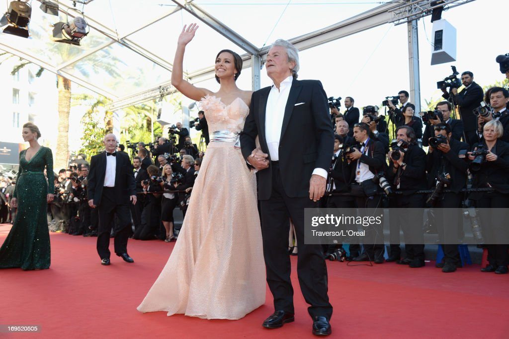 Actor Alain Delon and Marine Lorphelin attends the 'Zulu' Premiere and Closing Ceremony during the 66th Annual Cannes Film Festival at the Palais des Festivals on May 26, 2013 in Cannes, France.
