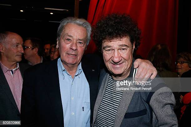 Actor Alain Delon and Singer Robert Charlebois pose after the Robert Charlebois '50 ans 50 chansons' Concert at Bobino on April 11 2016 in Paris...