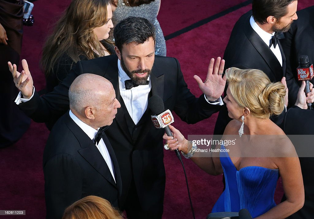 Actor Alan Arkin and actor/director Ben Affleck are interviewed as they arrive at the Oscars held at Hollywood & Highland Center on February 24, 2013 in Hollywood, California.