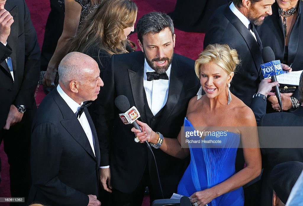 Actor Alan Arkin and actor/director Ben Affleck are interviewed by Nancy O'Dell as they arrive at the Oscars held at Hollywood & Highland Center on February 24, 2013 in Hollywood, California.