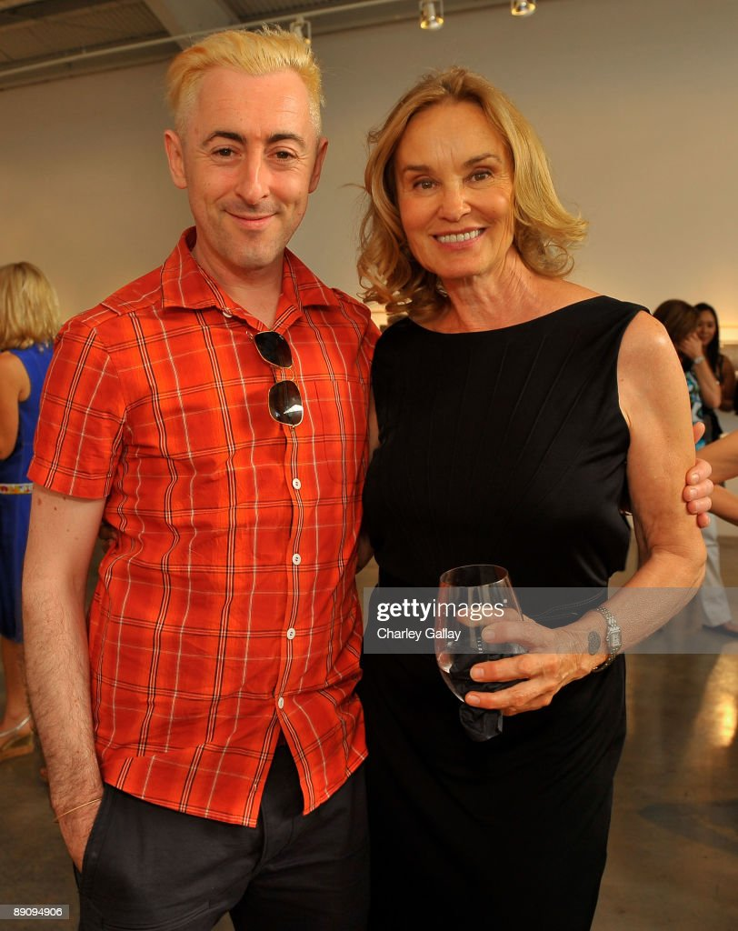 Actor <a gi-track='captionPersonalityLinkClicked' href=/galleries/search?phrase=Alan+Cumming&family=editorial&specificpeople=202521 ng-click='$event.stopPropagation()'>Alan Cumming</a> (L) and actress and photographer, Jessica Lange attend the reception of 'Jessica Lange: 50 Photographs 1992-2008' at The Rose Gallery on July 18, 2009 in Santa Monica, California.
