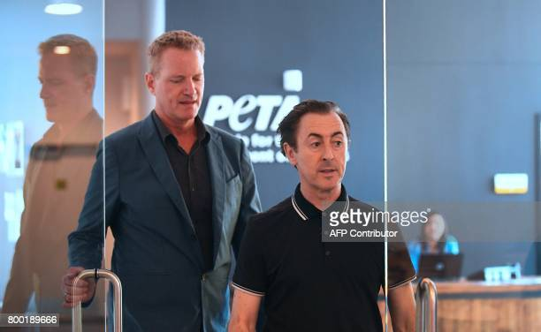 Actor Alan Cumming arrives at PETA June 23 in Los Angeles to announce a legal claim to transfer 11 chimpanzees that allegedly are languishing in a...