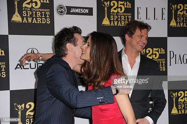 Actor Alan Cumming Livia Giuggioli and actor Colin Firth arrives at the 25th Film Independent Spirit Awards held at Nokia Theatre LA Live on March 5...