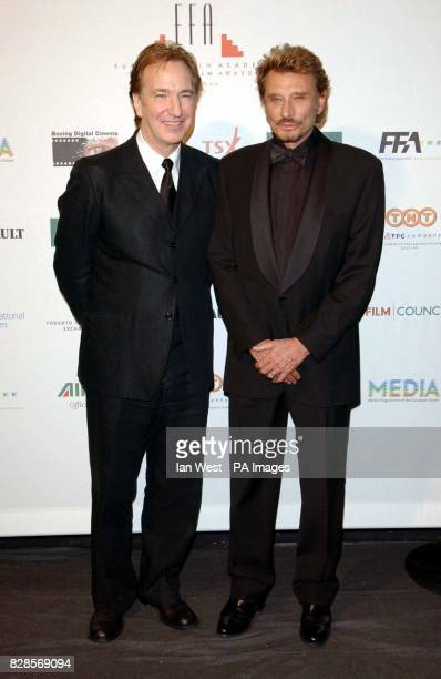 Actor Alan Rickman and Johnny Hallyday during the European Film Awards 2002 at the Teatro dell'Opera di Roma Rome Italy