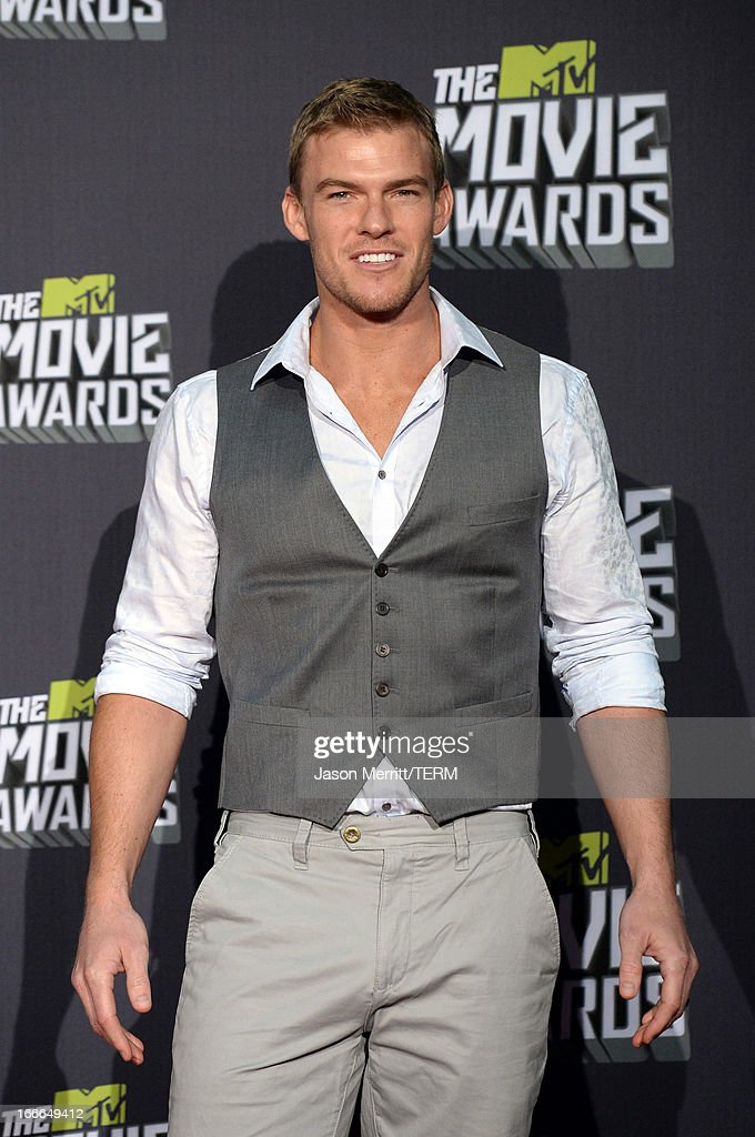 Actor Alan Ritchson poses in the press room during the 2013 MTV Movie Awards at Sony Pictures Studios on April 14 2013 in Culver City California