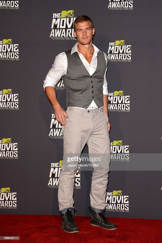 Actor <a gi-track='captionPersonalityLinkClicked' href=/galleries/search?phrase=Alan+Ritchson&family=editorial&specificpeople=4070667 ng-click='$event.stopPropagation()'>Alan Ritchson</a> poses in the press room during the 2013 MTV Movie Awards at Sony Pictures Studios on April 14, 2013 in Culver City, California.