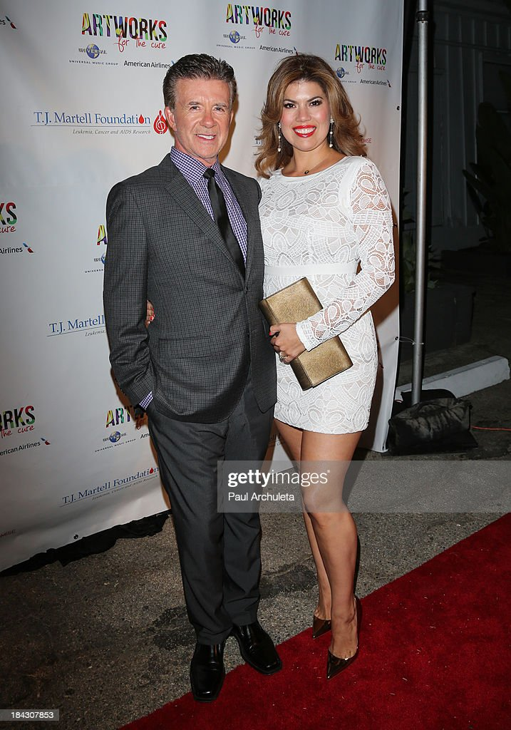 Actor Alan Thicke (L) and his wife Tanya Thicke attend The T.J. Martell Foundation's 3rd annual Artworks For The Cure charity event at Barker Hangar on October 12, 2013 in Santa Monica, California.