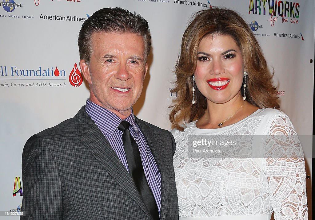 Actor <a gi-track='captionPersonalityLinkClicked' href=/galleries/search?phrase=Alan+Thicke&family=editorial&specificpeople=240157 ng-click='$event.stopPropagation()'>Alan Thicke</a> (L) and his wife Tanya Thicke attend The T.J. Martell Foundation's 3rd annual Artworks For The Cure charity event at Barker Hangar on October 12, 2013 in Santa Monica, California.