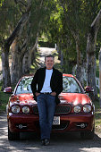 Actor Alan Thicke poses for photographs with his 2008 Jaguar XJ outside his home in Carpinteria December 1 2011