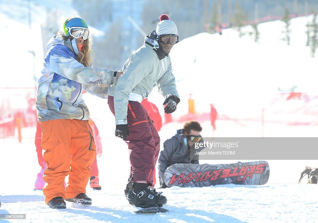 Actor Aldis Hodge and professional snowboarder The Dingo snowboard at the Oakley Learn To Ride In Collaboration With New Era on January 19, 2013 in Park City, Utah.