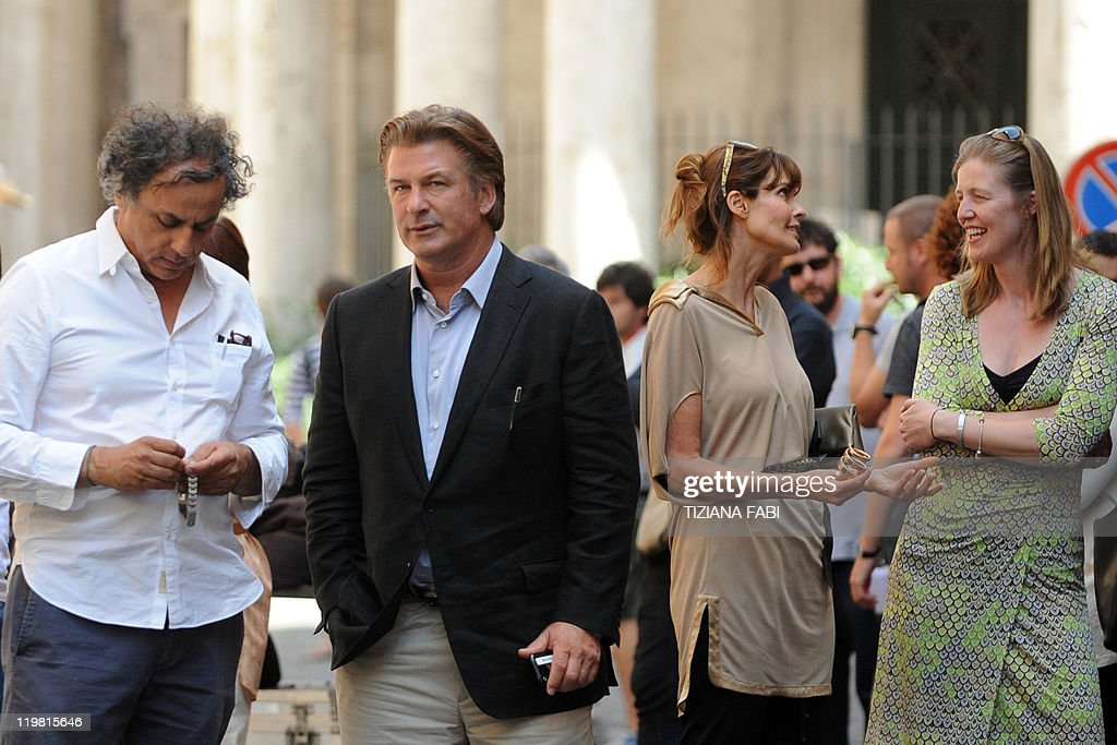 US actor Alec Baldwin and US actress and model Carol Alt speak with crew members on the set at Piazza della Pace in central Rome during the filming...