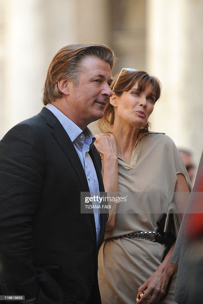 US actor Alec Baldwin and US actress and model Carol Alt stand on the set at Piazza della Pace in central Rome during the filming of US film director...