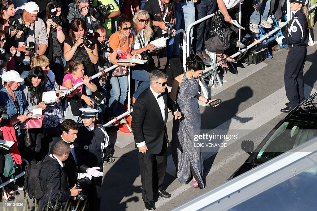 US actor Alec Baldwin (L) and wife Hilaria Thomas arrive on May 20, 2013 for the screening of the film 'Blood Ties' presented Out of Competition at the 66th edition of the Cannes Film Festival in Cannes. Cannes, one of the world's top film festivals, opened on May 15 and will climax on May 26 with awards selected by a jury headed this year by Hollywood legend Steven Spielberg.