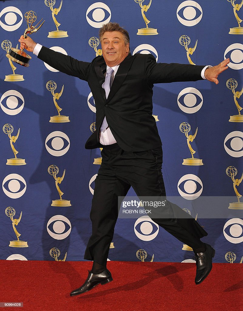 Actor <a gi-track='captionPersonalityLinkClicked' href=/galleries/search?phrase=Alec+Baldwin&family=editorial&specificpeople=202864 ng-click='$event.stopPropagation()'>Alec Baldwin</a> from the TV show '30 Rock' leaps as he holds the the Best Actor in a Comedy award, in the press room during the 2009 Emmy Awards at the Nokia Theater in Los Angeles on September 20, 2009. AFP PHOTO/Robyn BECK