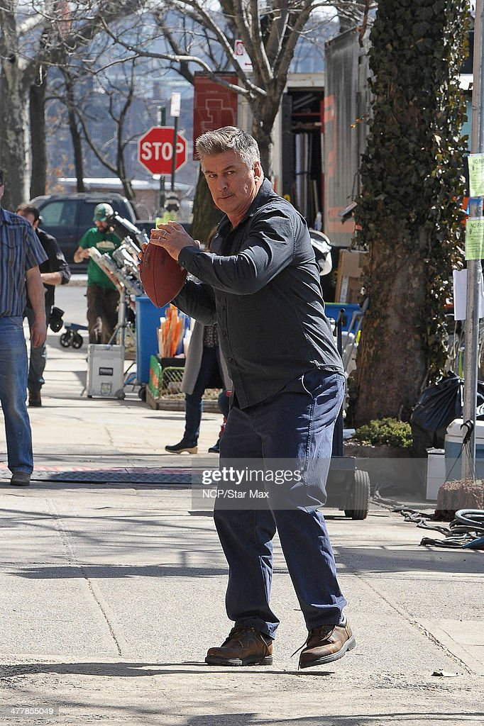 Actor Alec Baldwin is seen throwing a football on March 11, 2014 in New York City.