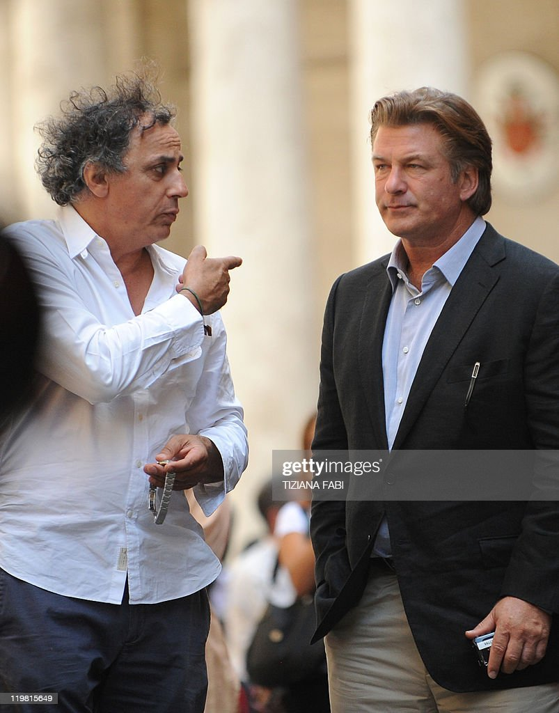 US actor Alec Baldwin listens to a crew member on the set at Piazza della Pace in central Rome during the filming of US film director Woody Allen's...