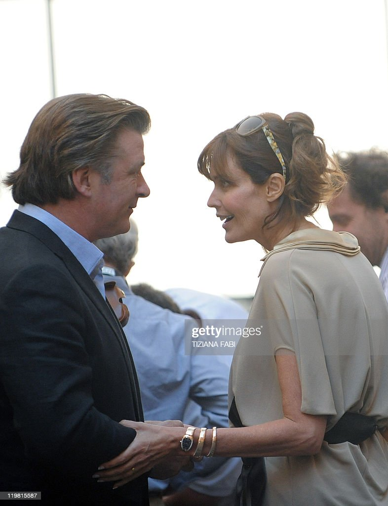 US actor Alec Baldwin listens to US actress and model Carol Alt at Piazza della Pace in central Rome during the filming of US film director Woody...