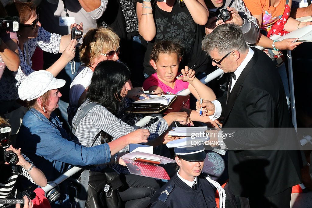 US actor Alec Baldwin (R) signs autographs on May 20, 2013 as he arrives for the screening of the film 'Blood Ties' presented Out of Competition at the 66th edition of the Cannes Film Festival in Cannes. Cannes, one of the world's top film festivals, opened on May 15 and will climax on May 26 with awards selected by a jury headed this year by Hollywood legend Steven Spielberg.