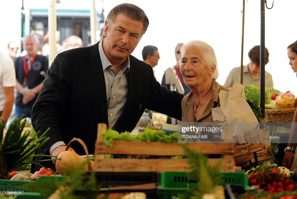 US actor Alec Baldwin stands with an unidentified woman on the set of US film director Woody Allen's latest production 'Bop Decameron' at Campo de'...
