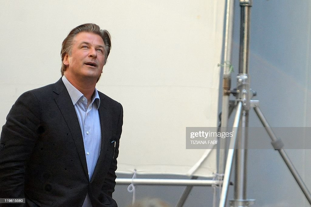 US actor Alec Baldwin walks on the set at Piazza della Pace in central Rome during the filming of US film director Woody Allen's new movie The Bop...