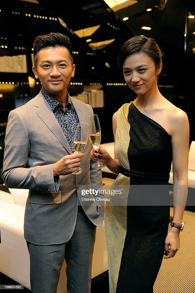 Actor Alec Su and actress Tang We pose for photographs during the IWC Flagship Boutique Opening on November 22, 2012 in Beijing, China.
