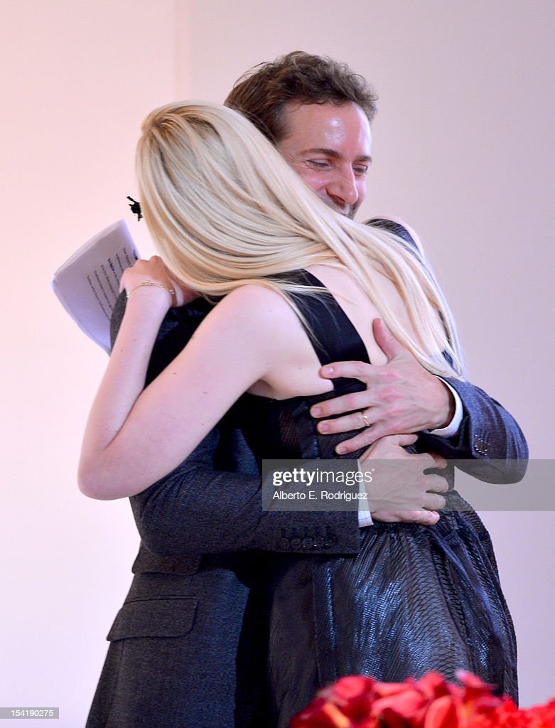 Actor Alessandro Nivola (L) and honoree Elle Fanning speak onstage at ELLE's 19th Annual Women In Hollywood Celebration at the Four Seasons Hotel on October 15, 2012 in Beverly Hills, California.