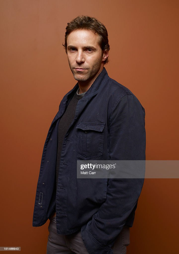 Actor <a gi-track='captionPersonalityLinkClicked' href=/galleries/search?phrase=Alessandro+Nivola&family=editorial&specificpeople=240468 ng-click='$event.stopPropagation()'>Alessandro Nivola</a> of 'Ginger And Rosa' poses at the Guess Portrait Studio during 2012 Toronto International Film Festival on September 7, 2012 in Toronto, Canada.