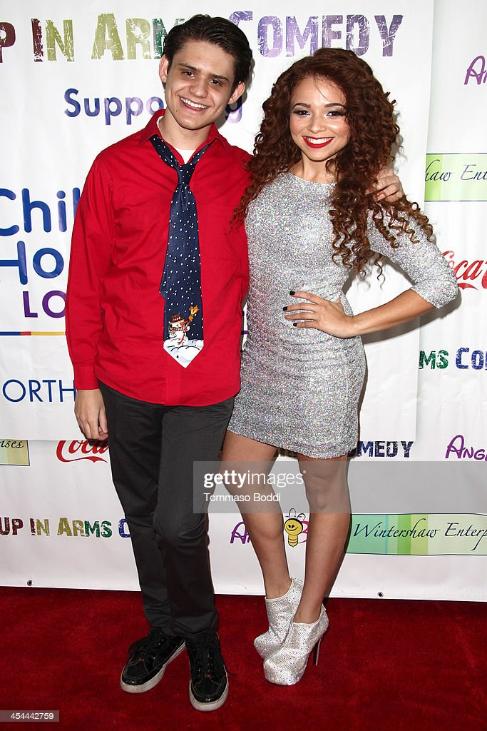 Actor Alex Dale (L) and recording artist Brittany Glodean attend the 'Up In Arms' comedy fundraiser benefiting Children's Hospital Los Angeles held at Park La Brea Theater on December 8, 2013 in Los Angeles, California.