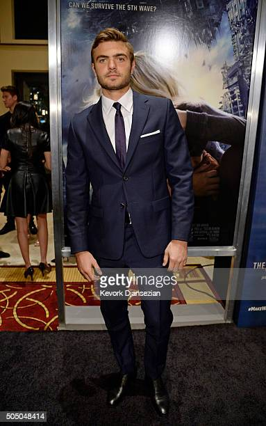 Actor Alex Roe poses the AwesomenessTV special fan screening of 'The 5th Wave' at Pacific Theatre at The Grove January 14 2016 in Los Angeles...