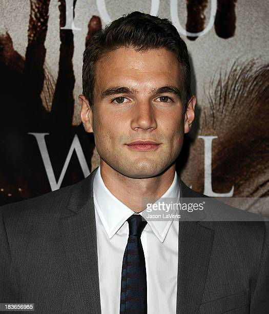 Actor Alex Russell attends the premiere of 'Carrie' at ArcLight Hollywood on October 7 2013 in Hollywood California
