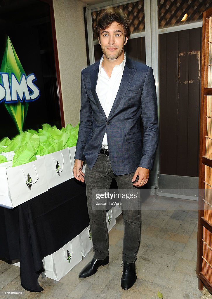 Actor Alexander Koch poses in the green room at the 2013 Teen Choice Awards at Gibson Amphitheatre on August 11, 2013 in Universal City, California.