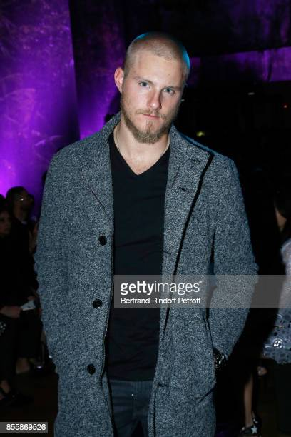 Actor Alexander Ludwig attends the Elie Saab show as part of the Paris Fashion Week Womenswear Spring/Summer 2018 on September 30 2017 in Paris France