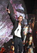 Actor Alexander Skarsgard accepts an award onstage during Spike TV's 'Scream 2010' at The Greek Theatre on October 16 2010 in Los Angeles California