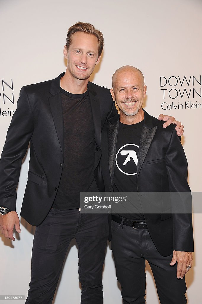 Actor Alexander Skarsgard (L) and designer Italo Zucchelli attends the Calvin Klein Collection post show event at Spring Studios on September 12, 2013 in New York City.