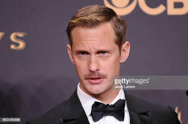 Actor Alexander Skarsgard poses in the press room at the 69th annual Primetime Emmy Awards at Microsoft Theater on September 17 2017 in Los Angeles...