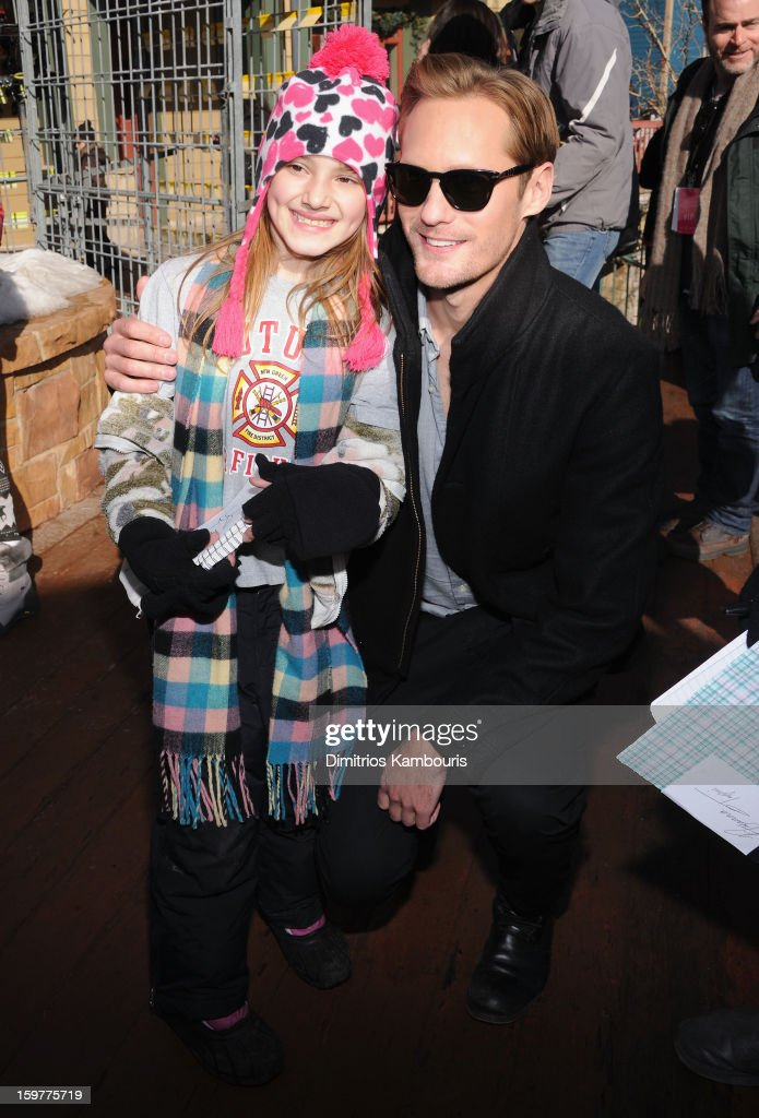 Actor Alexander Skarsgard (R) poses with a fan during Day 3 of Village At The Lift 2013 on January 20, 2013 in Park City, Utah.
