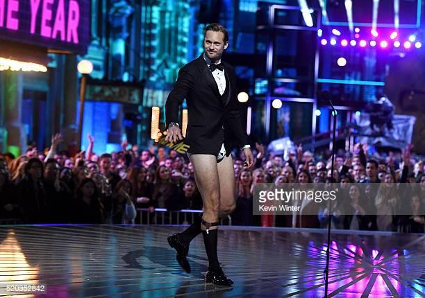 Actor Alexander Skarsgard walks onstage during the 2016 MTV Movie Awards at Warner Bros Studios on April 9 2016 in Burbank California MTV Movie...