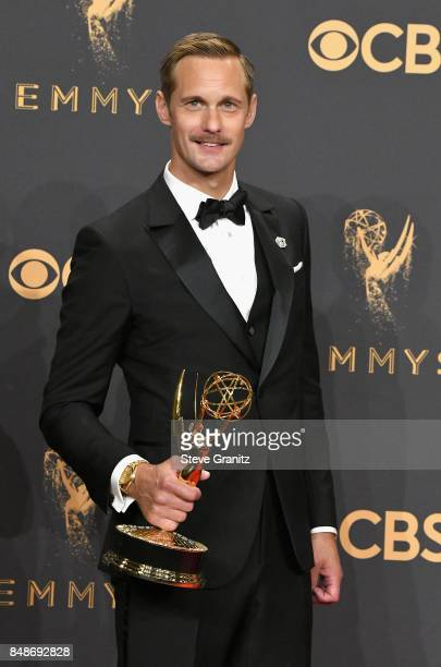 Actor Alexander Skarsgard winner of the award for Outstanding Supporting Actor in a Limited Series or Movie for 'Big Little Lies' poses in the press...