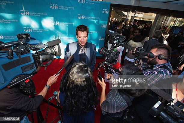 Actor Alexis Denisof speaks with media on the red carpet before a screening of 'Much Ado About Nothing' for the 39th Seattle International Film...
