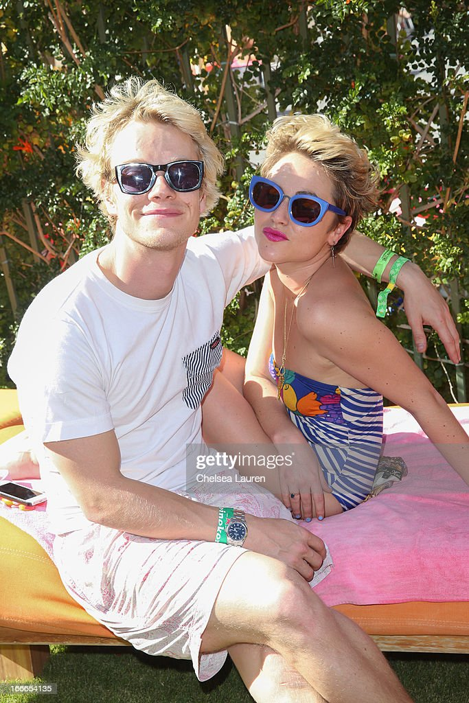 Actor Alfie Allen (L) and Jaime Winstone attend the House Of Holland eyewear pool party, hosted by Henry Holland and Io Echo, to launch the brand's new collection, in celebration of the Coachella Valley Music & Arts Festival 2013 at Saguaro Hotel on April 14, 2013 in Palm Springs, California.
