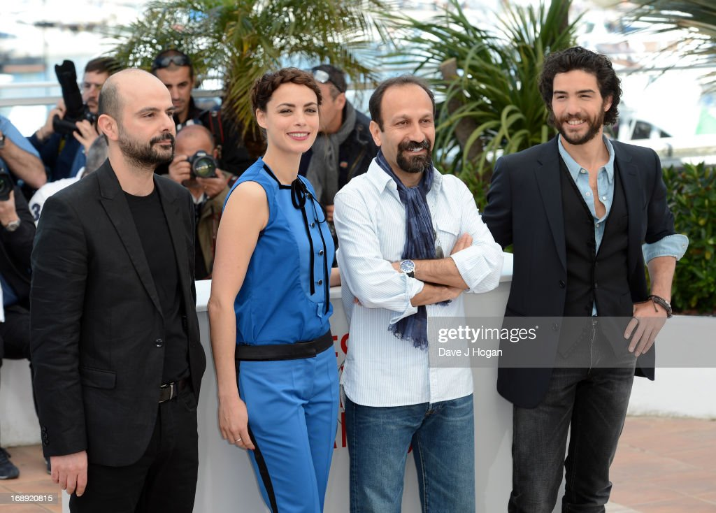 Actor <a gi-track='captionPersonalityLinkClicked' href=/galleries/search?phrase=Ali+Mosaffa&family=editorial&specificpeople=7664825 ng-click='$event.stopPropagation()'>Ali Mosaffa</a>, actress Berenice Bejo, director <a gi-track='captionPersonalityLinkClicked' href=/galleries/search?phrase=Asghar+Farhadi&family=editorial&specificpeople=5700577 ng-click='$event.stopPropagation()'>Asghar Farhadi</a> and actor <a gi-track='captionPersonalityLinkClicked' href=/galleries/search?phrase=Tahar+Rahim&family=editorial&specificpeople=5856944 ng-click='$event.stopPropagation()'>Tahar Rahim</a> attend 'Le Passe' photocall during the 66th Annual Cannes Film Festival at the Palais des Festivals on May 17, 2013 in Cannes, France.