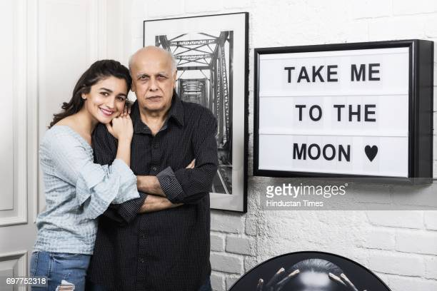Actor Alia Bhatt with her father and filmmaker Mahesh Bhatt at their house in Juhu on June 16 2017 in Mumbai India