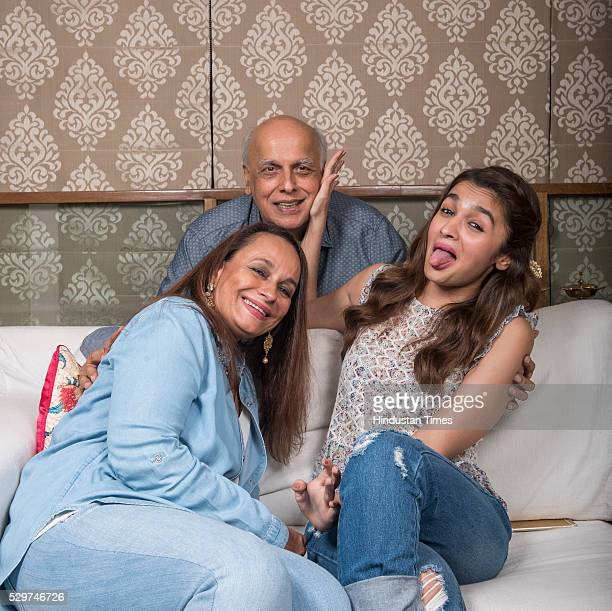 Actor Alia Bhatt with her mother Soni Razdan and father Mahesh Bhatt during a profile shoot at their Juhu house on May 4 2016 in Mumbai India